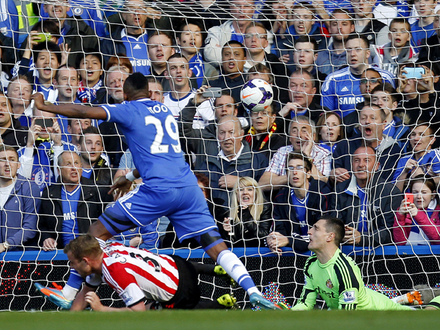 Chelsea's Samuel Eto'o scores his team's first goal beating Sunderland's Italian goalkeeper Vito Mannone during the English Premier League football match between Chelsea and Sunderland at Stamford Bridge in London on April 19, 2014