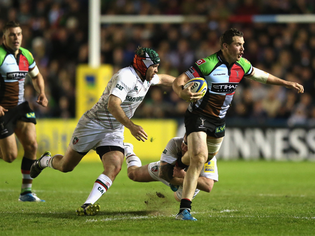 Tim Molenaar of Harlequins is held by Neil Briggs and Julian Salvi (L) during the Aviva Premiership match between Harlequins and Leicester Tigers at the Twickenham Stoop on April 18, 2014