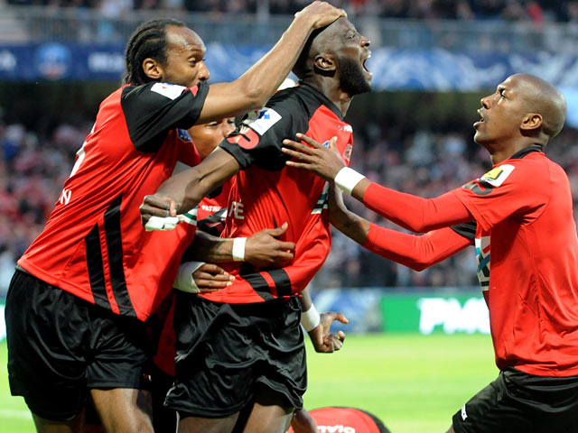 Guingamp's Mustapha Yatabare celebrates with team mates after scoring the opening goal against Monaco during the French Cup semi-final match on April 16, 2014