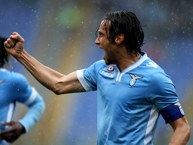 Lazio's Stefano Mauri celebrates after scoring the opening goal against Torino during the Serie A match on April 19, 2014