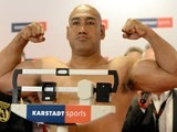 Australian boxer Alex Leapai gestures during the official weigh-in on April 25, 2014
