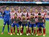Atletico Madrid's starting eleven pose for a photo moments before kick-off against Chelsea during the Champions League semi-final first leg match on April 22, 2014