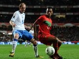 Elvir Rahimic of Bosnia attempts to win possession from Portugal winger Nani on November 11, 2011.