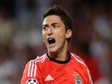 Filip Djuricic of SL Benfica celebrates scoring the opening goal of the match during the UEFA Champions League group stage match on September 17, 2013