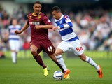 Ravel Morrison of Queens Park Rangers is challenged by Mathias Ranegie of Watford during the Sky Bet Championship match between Queens Park Rangers and Watford at Loftus Road on April 21, 2014