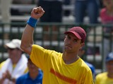 Colombian tennis player Santiago Giraldo celebrates after defeating Dominican Jose Hernandez during their Davis Cup Americas Group I second round singles tennis match at the 'Alvaro Carlos Jordan' tennis stadium in Cali, Colombia, on April 4, 2014