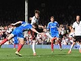 Hull's Shane Long heads in his team's second goal against Fulham during the Premier League match on April 26, 2014