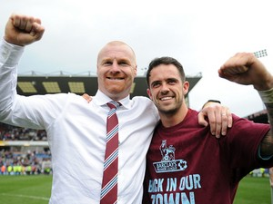 Burnley manager Sean Dyche celebrates with Danny Ings following the Sky Bet Championship match between Burnley and Wigan Athletic at Turf Moor on April 21, 2014