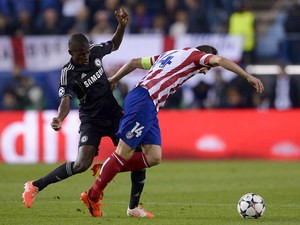 Chelsea's Ramires and Atletico's Gabi battle for the ball during the Champions League semi-final first leg match on April 22, 2014