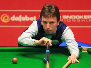 Ken Doherty of Ireland in action against Stuart Bingham of England during day one of the The Dafabet World Snooker Championship at Crucible Theatre on April 19, 2014