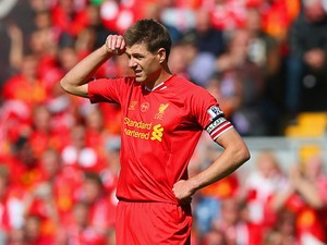Steven Gerrard of Liverpool looks on during the Barclays Premier League match between Liverpool and Chelsea at Anfield on April 27, 2014