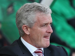 Stoke manager Mark Hughes watches his team against Tottenham during the Premier League match on April 26, 2014