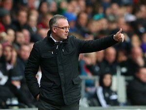 Villa manager Paul Lambert gives the thumbs up against Swansea during the Premier League match on April 26, 2014