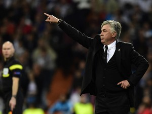 Real Madrid's Italian coach Carlo Ancelotti gestures during the UEFA Champions League semifinal first leg football match Real Madrid CF vs FC Bayern Munchen at the Santiago Bernabeu stadium in Madrid on April 23, 2014