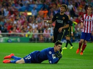 Atletico Madrid goalkeeper Thibaut Courtois saves from Barcelona striker Neymar on April 09, 2014.