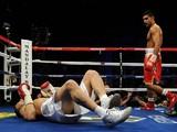 WBA super lightweight champion Amir Khan of England (R) looks at Marcos Maidana of Argentina on December 11, 201
