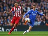 Mario Suarez of Club Atletico de Madrid closes down Fernando Torres of Chelsea during the UEFA Champions League semi-final second leg match between Chelsea and Club Atletico de Madrid at Stamford Bridge on April 30, 2014