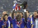 France defender Lilian Thuram lifts the European Championships trophy on July 02, 2000.