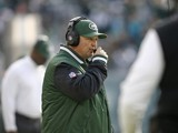 New York Jets offensive coordinator Marty Mornhinweg walks the sidelines during their game against the Miami Dolphins at MetLife Stadium on December 1, 2013