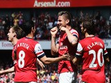 Olivier Giroud (C) of Arsenal celebrates with team mates after scoring during the Barclays Premier League match against West Bromwich Albion on May 4, 2014