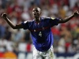 Former Arsenal midfielder Patrick Vieira celebrates scoring for France on June 13, 2004.