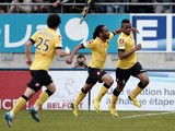 Sochaux French and Ghanaian forward Jordan Ayew celebrates with teammates after scoring a goal during the French L1 football match between Sochaux (FCSM) and Nice (OGCN) on May 4, 2014