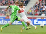 Wolfsburg's midfielder Kevin de Bruyne and Stuttgart's Japanese defender Gotoku Sakai vie for the ball during the German first division Bundesliga football match VfB Stuttgart vs VfL Wolfsburg in Stuttgart, southern Germany, on May 3, 2014