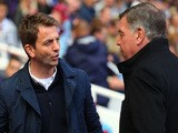 Tim Sherwood the Spurs manager is greeted by Sam Allardyce the West Ham manager during the Barclays Premier League match on May 3, 2014