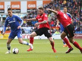 Fernando Torres of Chelsea moves away from Aron Gunnarsson during the Barclays Premier League match between Cardiff City and Chelsea at the Cardiff City Stadium on May 11, 2014