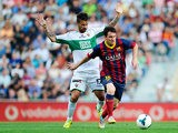 Barcelona's Lionel Messi and Elche's Javi Marquez in action during the La Liga match on May 11, 2014