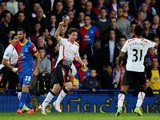 Joe Allen of Liverpool celebrates after scoring the opening goal during the Barclays Premier League match between Crystal Palace and Liverpool at Selhurst Park on May 5, 2014