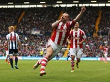 Charlie Adam of Stoke City celebrates as he scores their second goal during the Barclays Premier League match between West Bromwich Albion and Stoke City at The Hawthorns on May 11, 2014