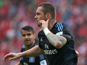 Hamburg's forward Pierre-Michel Lasogga celebrates after scoring the 1-1 during the German first division Bundesliga football match FSV Mainz 05 vs Hamburger SV, in Mainz western Germany, on May 10, 2014
