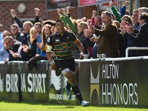 Luther Burrell of Northampton Saints celebrates after scoring a try during the Aviva Premiership match between Northampton Saints and London Wasps at Franklin's Gardens on May 10, 2014