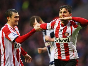 Fabio Borini of Sunderland celebrates with Adam Johnson as he scores their second goal during the Barclays Premier League match between Sunderland and West Bromwich Albion at Stadium of Light on May 7, 2014