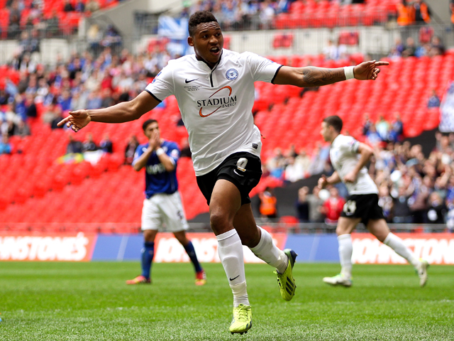 Britt Assombalonga of Peterborough celebrates after scoring his team's third goal of the game during the Johnstone's Paint Trophy Final between Chesterfield and Peterborough United at Wembley Stadium on March 30, 2014