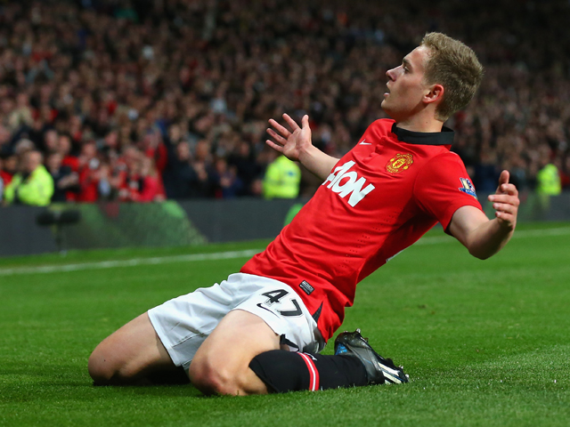James Wilson of Manchester United celebrates scoring the second goal during the Barclays Premier League match between Manchester United and Hull City at Old Trafford on May 6, 2014