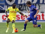 Nantes' French defender Issa Cissokho vies with Bastia's French midfielder Yannick Cahuzac during the French L1 football match Bastia (SCB) against Nantes (FCN) on May 17, 2014