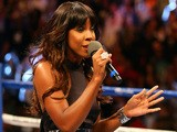 Singer Kelly Rowland performs the national anthem before Floyd Mayweather Jr. takes on Robert Guerrero in their WBC welterweight title bout on May 4, 2014