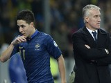 France's midfielder Samir Nasri (L) leaves the pitch next to France's head coach Didier Deschamps during the FIFA World Cup 2014 qualifying football match Ukraine vs France on November 15, 2013