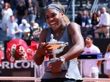 Serena Williams of USA celebrates with the winners trophy after defeating Sara Errani of Italy in the final during day eight of the Internazionali BNL d'Italia  on May 18, 2014