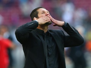 Diego Simeone the coach of Club Atletico de Madrid celebrates towards his supporters after winning the La Liga after the match between FC Barcelona and Club Atletico de Madrid at Camp Nou on May 17, 2014