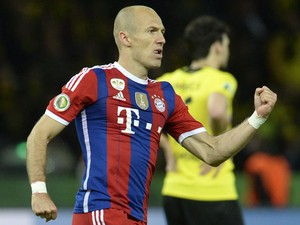 Bayern Munich's Dutch midfielder Arjen Robben celebrates scoring during the extra-time of the DFB German Cup final football match BVB Borussia Dortmund vs Bayern Munich at the Olympic Stadium in Berlin on May 17, 2014