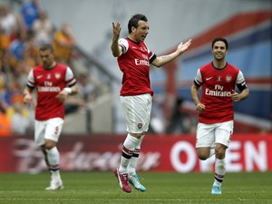 Arsenal's Spanish midfielder Santi Cazorla celebrates scoring his team's first goal during the English FA Cup final match between Arsenal and Hull City at Wembly Stadium in London on May 17, 2014