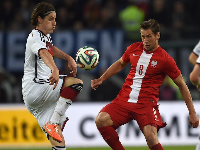 Poland's midfielder Grzegorz Krychowiak (R) and Germany's midfielder Sebastian Rudy vie for the ball during the International friendly on May 13, 2014