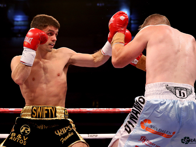 Stephen Smith in action with Gary Buckland during their British Super-Featherweight Championship bout at Motorpoint Arena on August 17, 2013