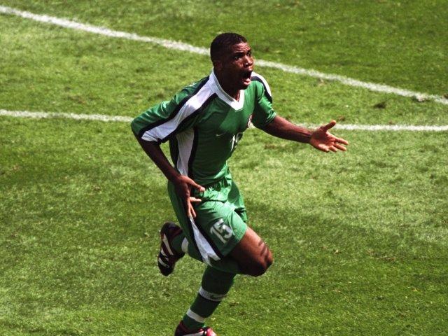 Midfielder Sunday Oliseh celebrates scoring at the World Cup on June 13, 1998.