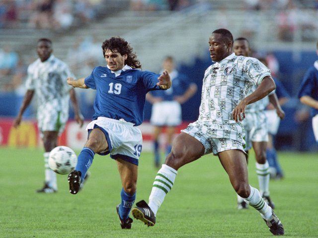 Nigerian defender Uche Okechukwu makes a clearance against Greece on June 30, 1994.