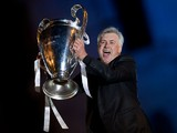 Head coach Carlo Ancelotti of Real Madrid CF holds the UEFA Champions League cup celebrating their victory on the UEFA Champions League Final match against Club Atletico de Madrid at Cibeles square on the early morning of May, 25, 2014