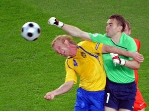 Russia goalkeeper Igor Akinfeev punches clear the danger against Sweden on June 18, 2008.